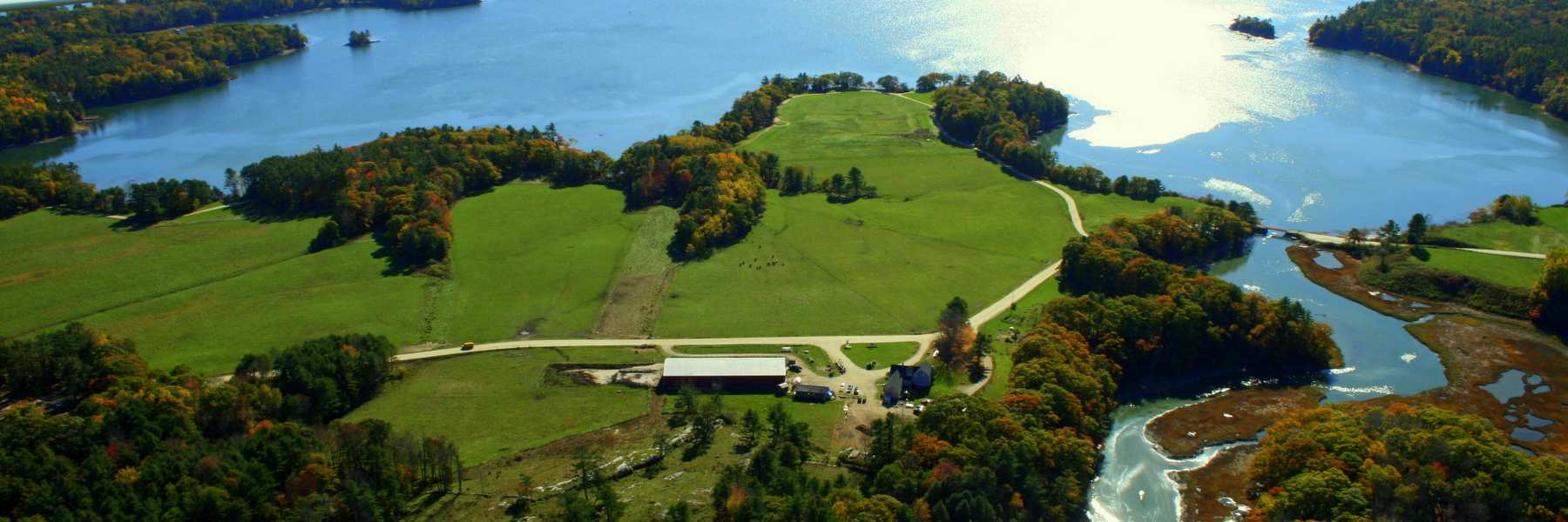 Wolfe's Neck Farm Headquarters and pastureland on Casco Bay